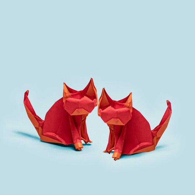 Origrami of two red kittens